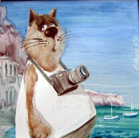 Коты, как и люди, любят что-то сфотографировать на память