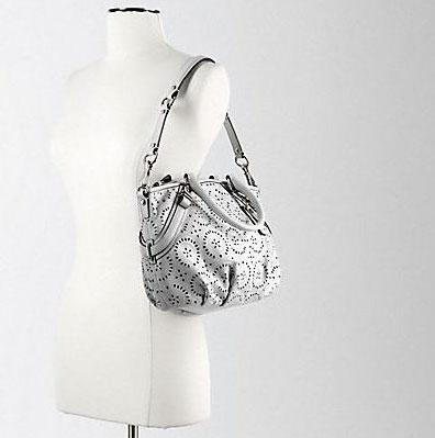 Ажурная сумка для путешествий от Coach. — фото 4