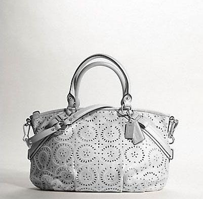 Ажурная сумка для путешествий от Coach. — фото 1